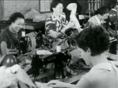 B/W 1934 women sewing at machines in WPA garment factory / documentary