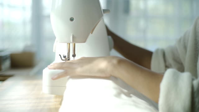 cu: women sewing garment in sewing class - sewing machine stock videos & royalty-free footage