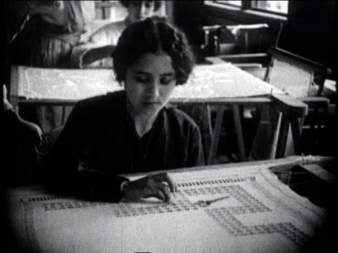 1930 montage women sewing on large pieces of fabric / mexico city, mexico - anno 1930 video stock e b–roll
