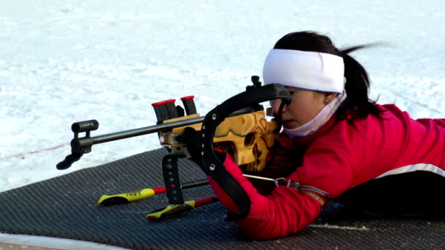 hd: women shooting at biathlon competition - biathlon stock videos and b-roll footage