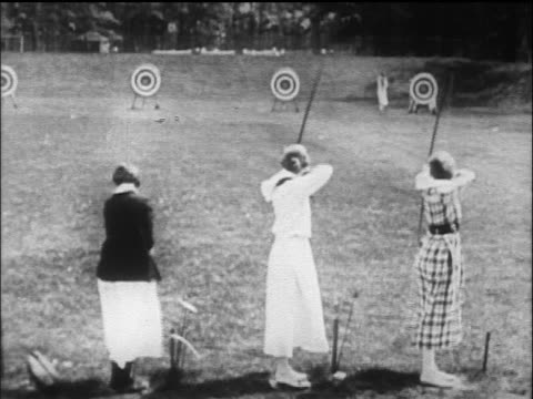 b/w 1916 rear view 2 women shooting in archery / wellesley college, ma - wellesley massachusetts stock videos and b-roll footage