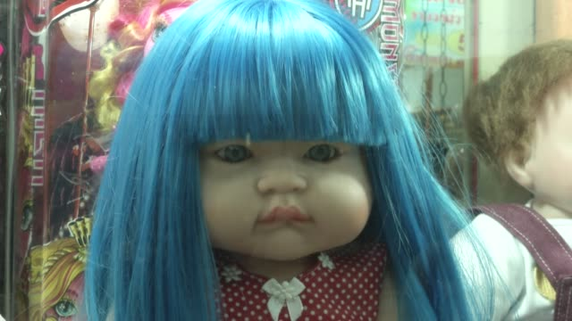 women shop and care for luk thep dolls literally translates as child angels and people believe they bring good fortune and they are pampered by their... - puppe stock-videos und b-roll-filmmaterial