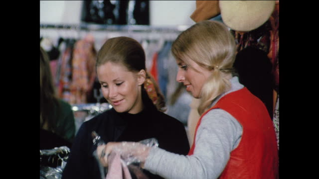 montage women shop for clothes and attend a fashion show / uk - modenschau stock-videos und b-roll-filmmaterial