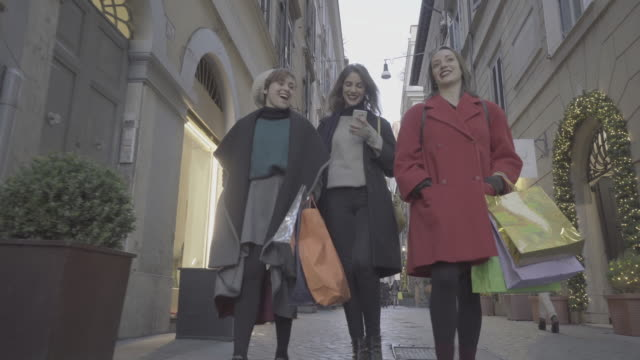 women shopping during winter sales in rome, italy - wealth stock videos & royalty-free footage