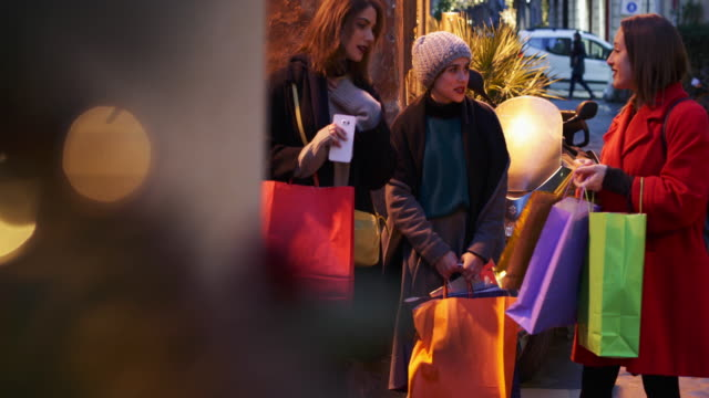 Women shopping during winter sales in Rome, Italy