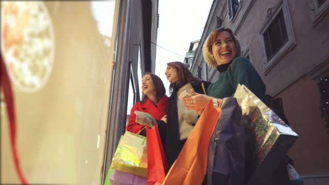 women shopping during winter sales in rome, italy - shopping bag stock videos & royalty-free footage