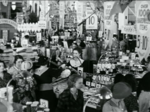 B/W 1938 women shopping in crowded 5 and 10 store / industrial