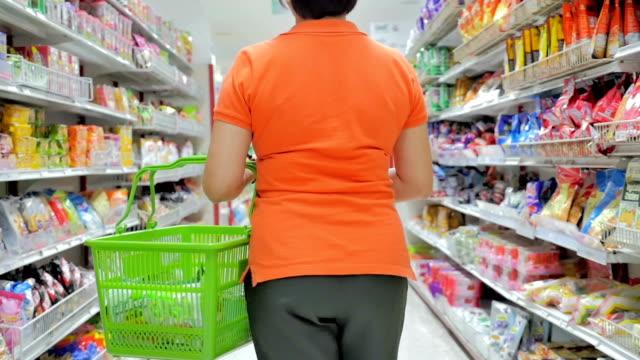 Women shopping in supermarket,Slow motion