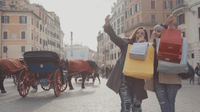 Women shopping take a selfie in Piazza di Spagna