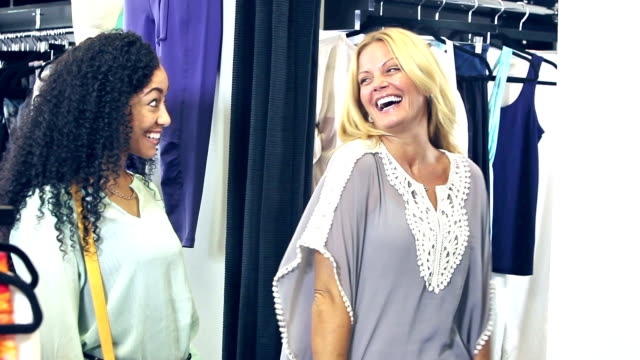 women shopping together in clothing store - clothing store stock videos and b-roll footage