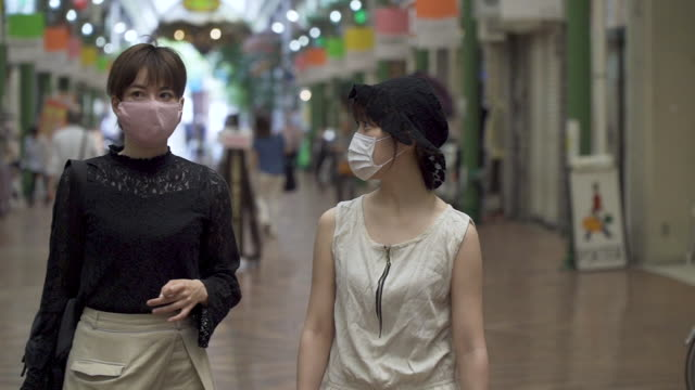 women shopping with protective face masks on - japan stock videos & royalty-free footage
