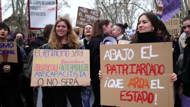 women shout slogans and hold a placard during a protest during international women's day on march 08 2020 in madrid spain spain celebrates... - 国際女性デー点の映像素材/bロール