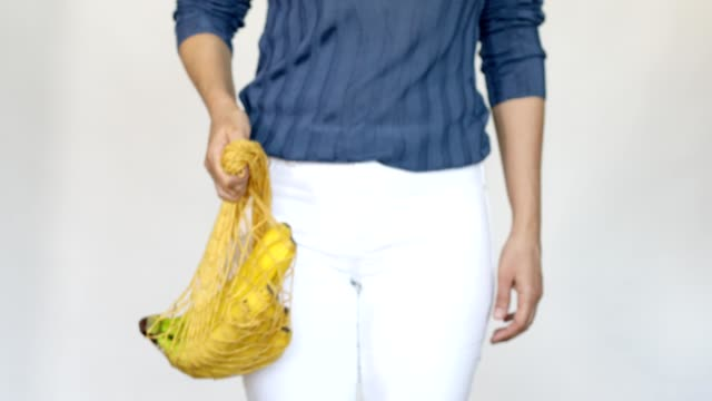 women showing bananas in shopping bag - reusable bag stock videos & royalty-free footage