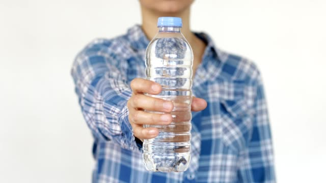 women showing water bottle towards the camera - water bottle stock videos & royalty-free footage