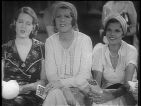 vídeos y material grabado en eventos de stock de b/w 1931 3 women sitting in audience + sighing with dreamy expressions / short - blanco y negro