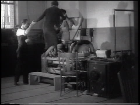 b/w 1933 2 women sitting in bouncing chair in vibration-tester experiment / purdue u., indiana - 1933 stock videos & royalty-free footage