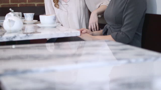women sitting in coffee shop - greater london stock videos & royalty-free footage