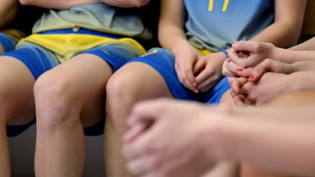women sitting in locker room - locker room stock videos and b-roll footage