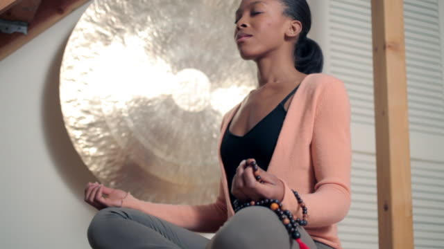 women sitting in lotus position - gambe incrociate video stock e b–roll