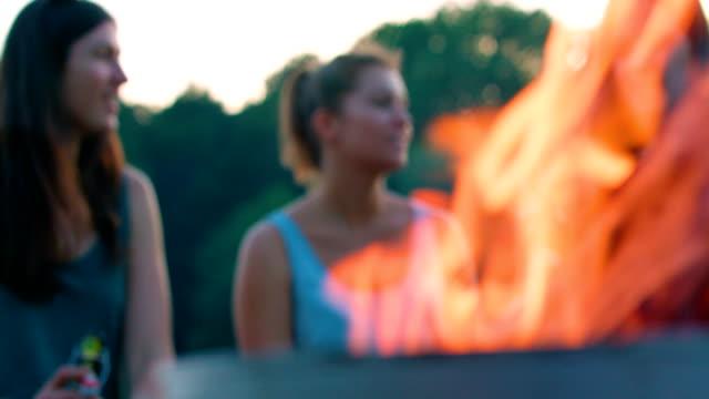 women sitting near the grill - grigliare video stock e b–roll