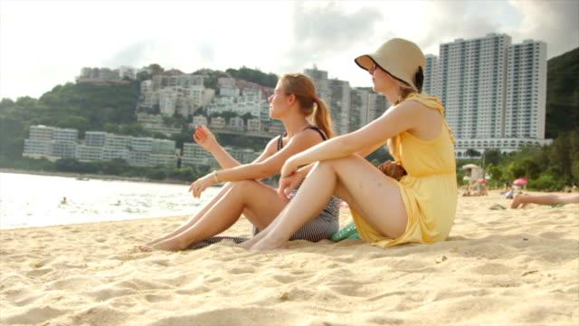 Women Sitting on a Beach in Hong Kong