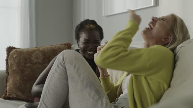 women sitting on sofa talking and laughing / cedar hills, utah, united states - gossip stock videos & royalty-free footage