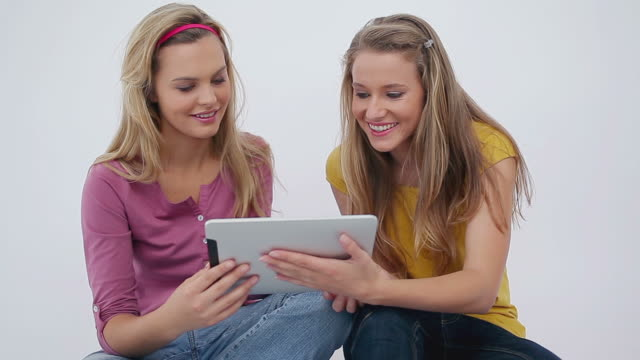 women sitting while using an ebook - hair accessory stock videos & royalty-free footage