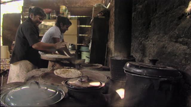 ms women smiling and flipping tortillas / oaxaca, mexico - tortilla flatbread stock videos & royalty-free footage