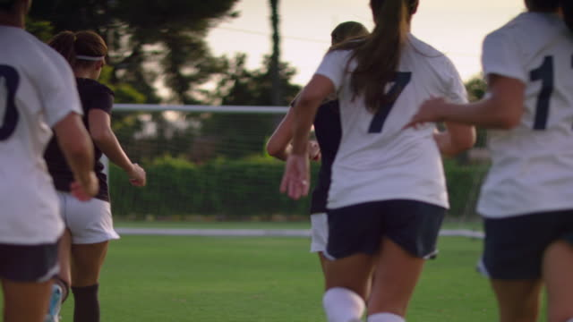 WS Women soccer team runing towards goal during practice / Riverside, California, United States