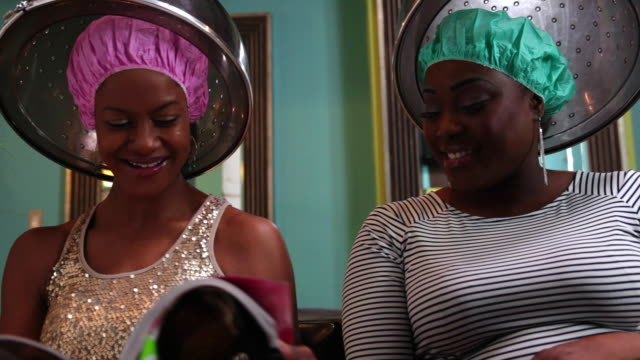 ms women socializing at  beauty parlor  / irvington, new jersey, united states - sich verschönern stock-videos und b-roll-filmmaterial