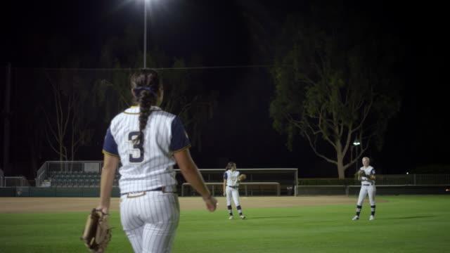 vídeos y material grabado en eventos de stock de ws r/f 3 women softball players playing warmup catch in ground / riverside, california, united states  - sófbol