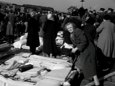 women sort out bandages and blankets at the scene of the harrow wealdstone railway crash - bedclothes stock videos & royalty-free footage