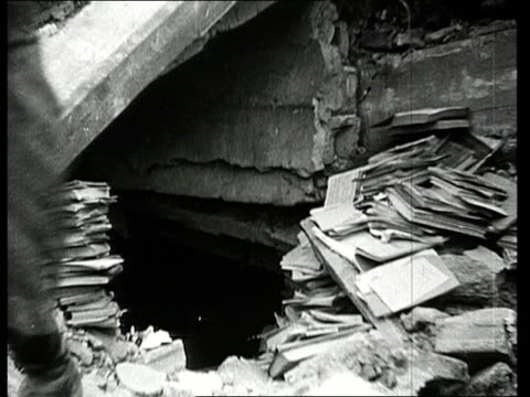vidéos et rushes de women sorting and carrying books from ruins in aftermath of world war ii/ women sorting letters for survivors/ women sitting together among ruins/... - survie