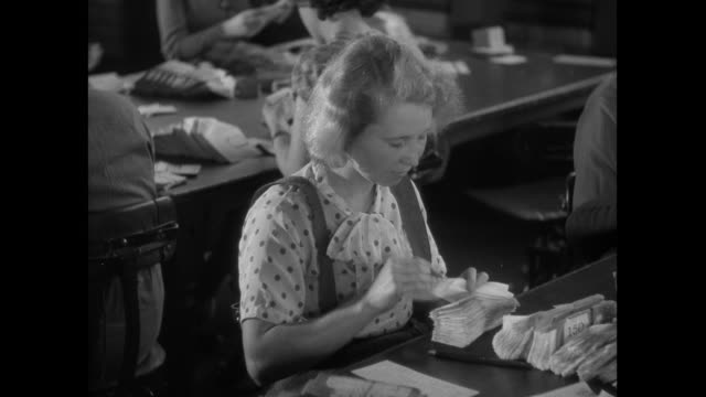 montage women sorting through mail vouchers at a bank / united kingdom - black and white stock videos & royalty-free footage