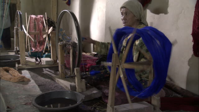 women spinning silk, hetian, xinjiang province, china - bbc stock videos and b-roll footage