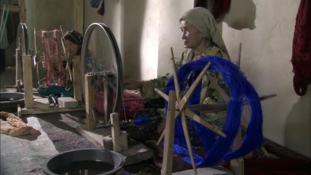 Women spinning silk, Hetian, Xinjiang province, China