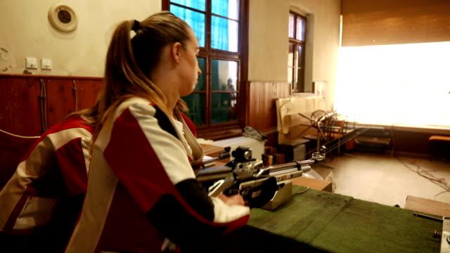 women sport shooter training - gun stock videos & royalty-free footage