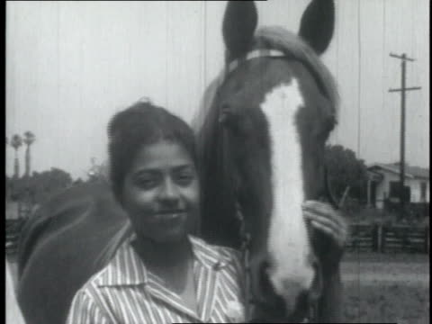 women stand in front of their horses / united states - sportlerin stock-videos und b-roll-filmmaterial