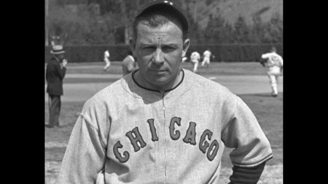 women standing by large baseball made of flowers manager jimmy dykes stands in front of baseball chicago white sox players running from behind... - spring training stock videos & royalty-free footage
