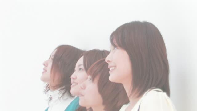 Women standing side by side