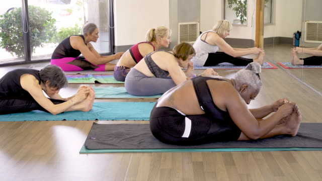 women stretching in exercise class - long beach california stock videos & royalty-free footage