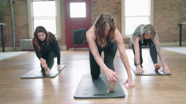 Women Stretching in Fitness Class