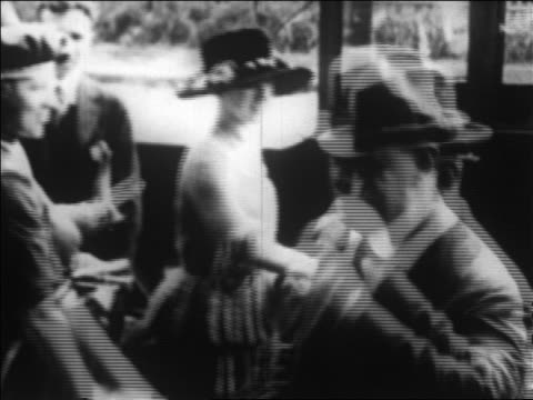 B/W 1920 women suffragettes handing out pamphlets in camapign to get the vote / newsreel