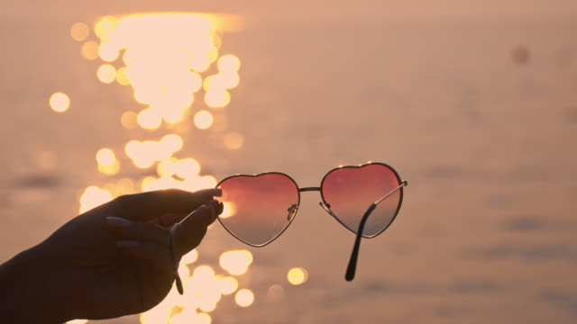 slo mo women sunglasses in the shape of a heart - sunglasses stock videos & royalty-free footage