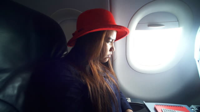 women take a nap on airplane - negative emotion stock videos & royalty-free footage