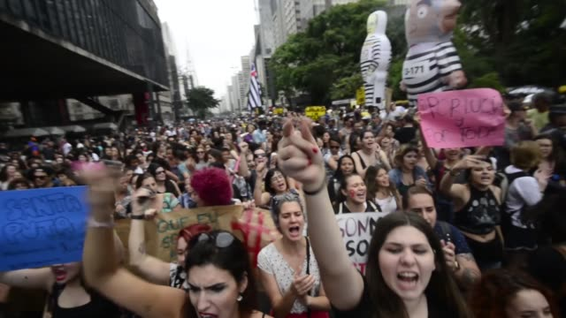 women take part in a march in sao paulo on october 23 to protest against violence against women and in solidarity for the brutal killing of a... - argentina stock videos & royalty-free footage