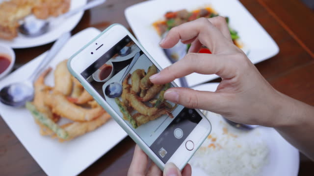 women take photos of food by smartphone,close-up - sharing stock videos & royalty-free footage