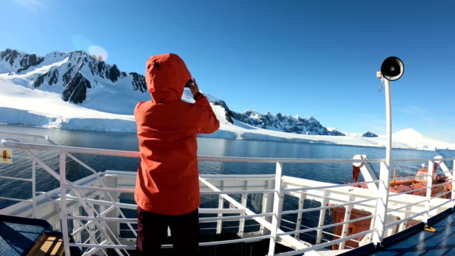 women take pictures on an antarctic ship - antarctica people stock videos & royalty-free footage