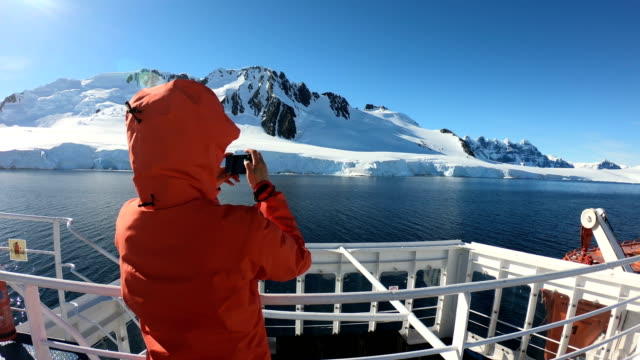 Women take pictures on an Antarctic ship