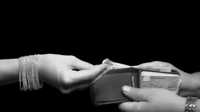 women taking money - husband stock videos & royalty-free footage